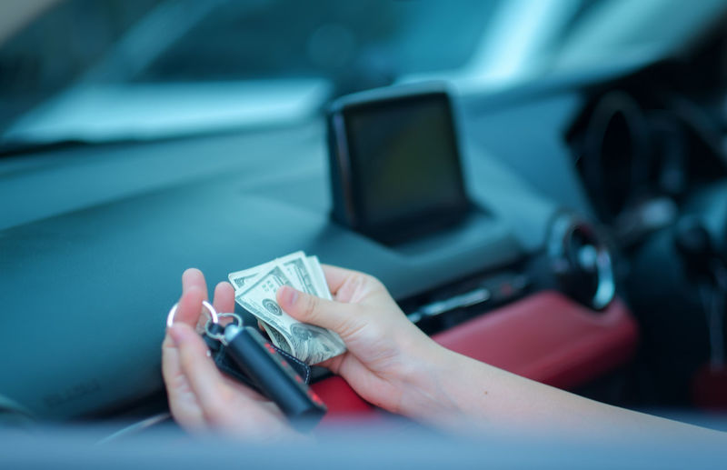Closeup hand asia woman sitting in her new white car showing keys, holding dollar Personal transportation purchase concept Human Hand Hand Car Motor Vehicle Human Body Part Mode Of Transportation Transportation Selective Focus One Person Land Vehicle Real People Car Interior Technology Vehicle Interior Holding Lifestyles Indoors  Body Part Leisure Activity Finger