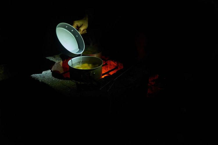 High angle view of lit tea light candle
