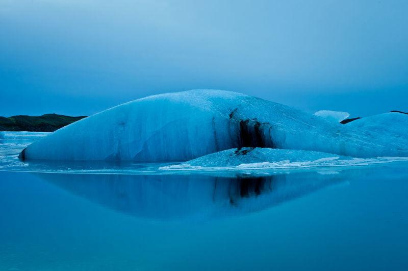 jolulsarlon iceberg - iceland - landscape Blue Ice Iceberg Jokulsarlon Lake Jökulsárlón Jökulsárlón Glaciar Lagoon Nature Sea Water Landscape With Whitewall