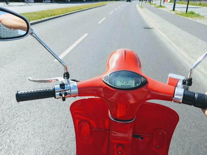Close-Up Of Red Scooter On Road
