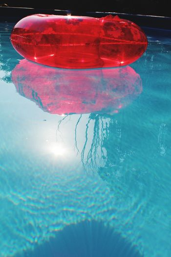 reflexes Water Nature Red Reflection Blue No People Pool Day Outdoors Floating Swimming Pool Sunlight Close-up Waterfront Pink Color Sea Floating On Water