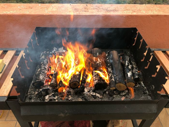 Fuego y leña Fire Fire - Natural Phenomenon Heat - Temperature Flame No People Wood - Material Orange Color Barbecue Grill Nature Fireplace High Angle View Outdoors Barbecue Glowing Coal Metal Motion Food Preparation
