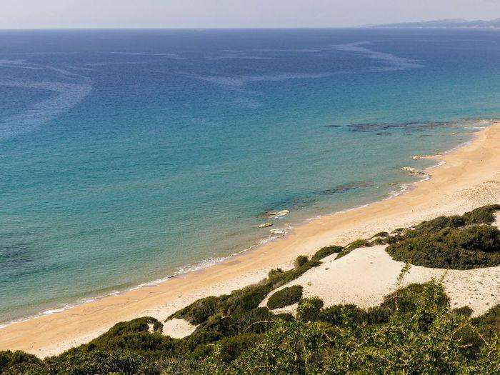 the golden beach Cyprus Water Sea Beach Sand Sand Dune Sky Horizon Over Water Landscape Coastline Arid Climate Atmospheric Seascape Coast Calm Geology Desert Ocean Rocky Coastline Arid Landscape Arid Physical Geography Sandy Beach