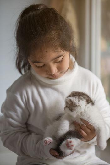 Cute Girl Holding Kitten