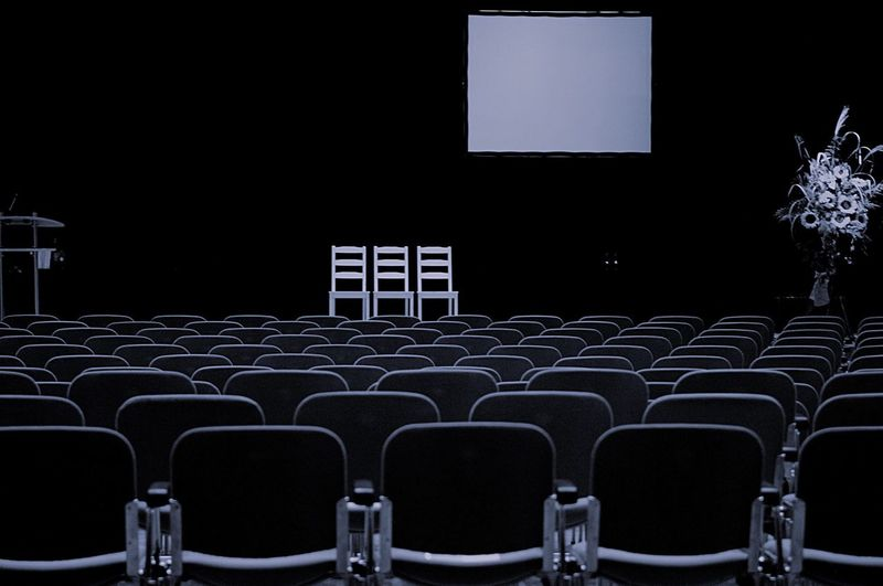 Empty chairs in row at night