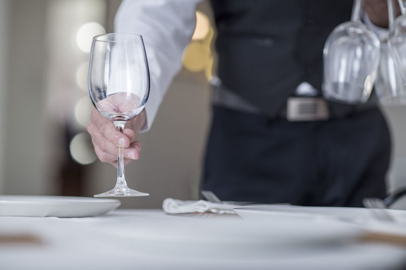 Midsection of man preparing food on table in restaurant