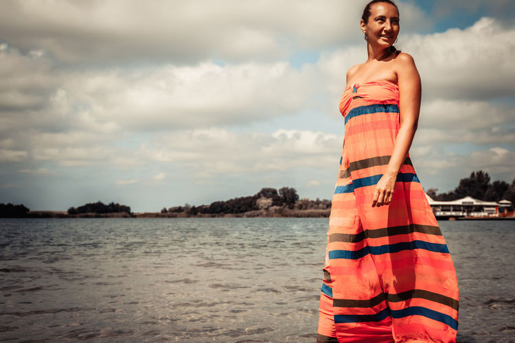 Smiling woman enjoying in summer day at the beach.