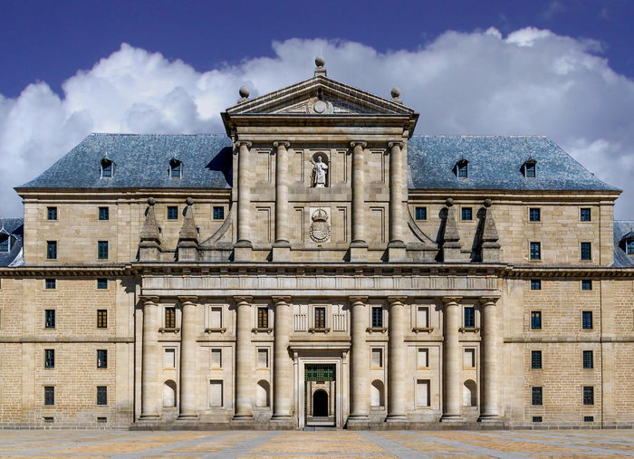 Front facade of the Monastery of Saint Lawrence - San Lorenzo de El Escorial, Spain Architectural Feature Architecture Baroque Style Bell Tower - Tower Building Exterior Built Structure City City Life Day Entrance Façade Famous Place History Monument Old Town Outdoors Palace Past Pediment Sky The Past Tourism Town Hall Travel Destinations Window