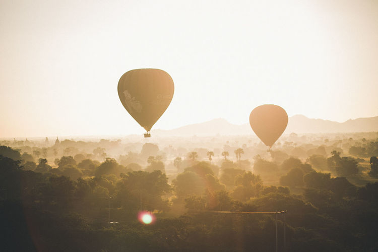 Hot Air ballon ride in Bagan. Air Vehicle Balloon Ballooning Festival Beauty In Nature Clear Sky Flying Hot Air Balloon Landscape Nature Orange Color Scenics - Nature Sky Sun Sunlight Transportation