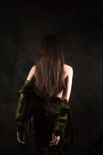 Adult Beautiful Woman Beauty Black Background Brown Hair Clothing Dark Dress Fashion Females Hair Hairstyle Human Hair Indoors  Long Hair One Person Rear View Studio Shot Women Young Adult Young Women
