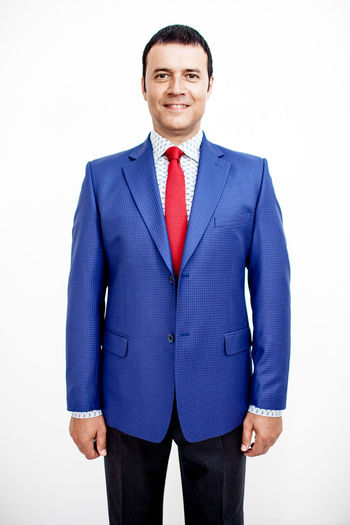 Man in classic suit on the white background. Studio shot. Business Business Stories Classic Full Suit Happy Looking At Camera Man Suit Blue Business Finance And Industry Businessman Catalogue Clothes Costume Jacket Look Male Men One Man Only One Person Smile Style Tie White White Background