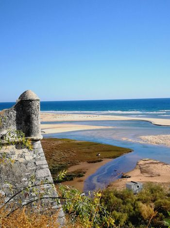 Sea Beach Water Horizon Over Water Sand Blue Clear Sky Outdoors No People Beauty In Nature Sky Looking At Camera Built Structure Architecture History No Filter, No Edit, Just Photography Ria Formosa Cacela Velha Portugal