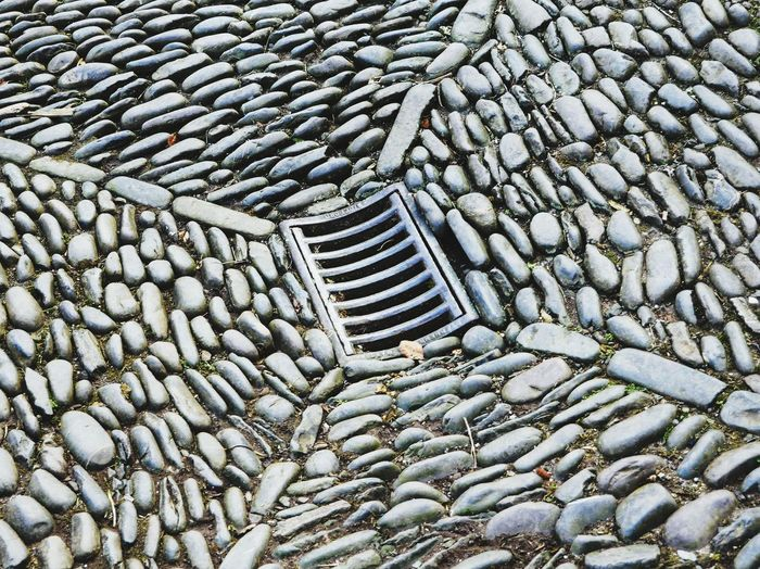 High angle view of drain on road