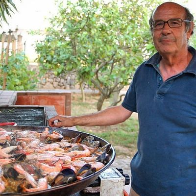 José preparing the paella for the guests of the Finca SonEstrany near Llucmajor Mallorca SPAIN