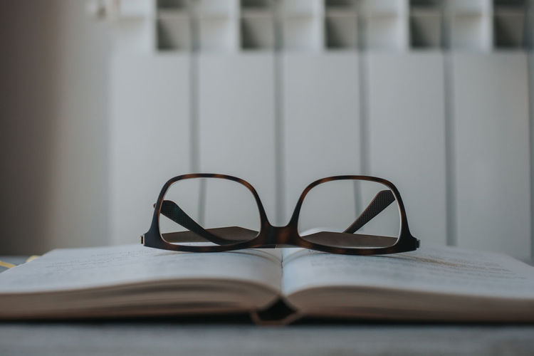 Eyeglasses  Glasses Book Publication Eyeglasses  Eyewear Surface Level Wisdom Paper Eyesight Personal Accessory Absence Focus On Foreground Education No People Selective Focus Close-up Still Life Table Indoors  Break Reading Rest Learning Studying