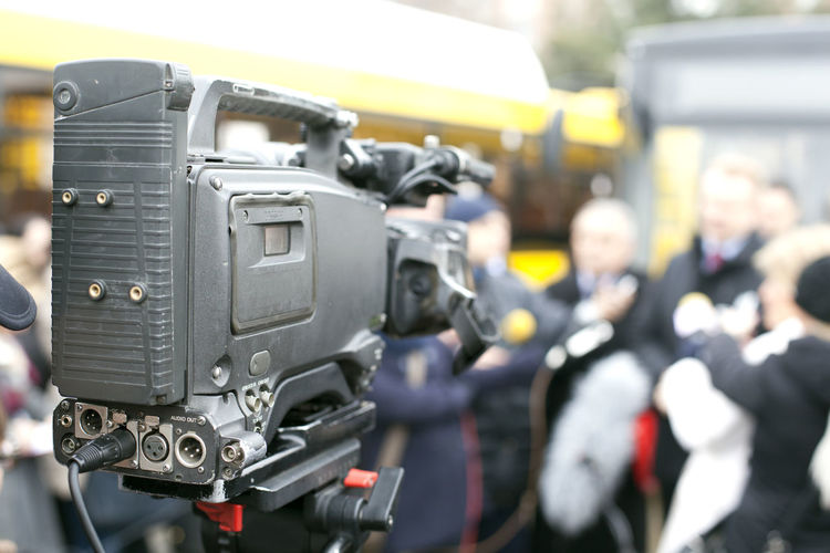 Close-Up Of Camera Against Crowd
