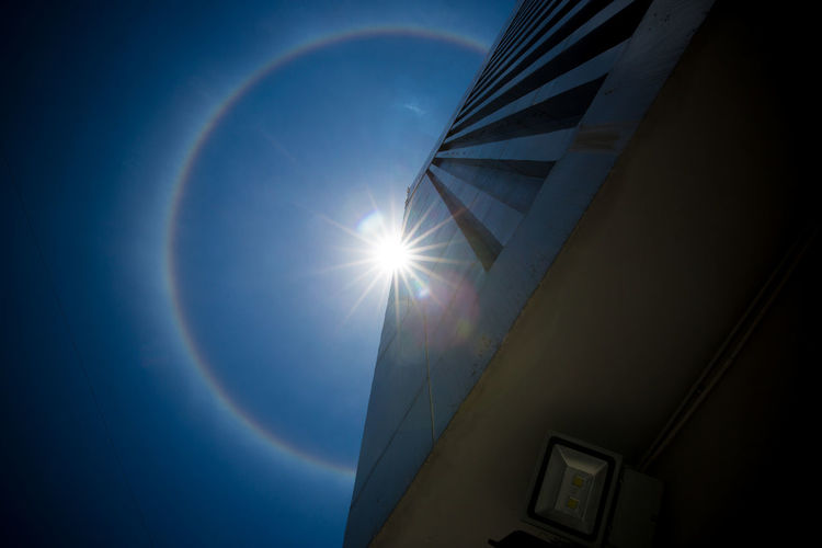 Low angle view of bright sun on sunny day