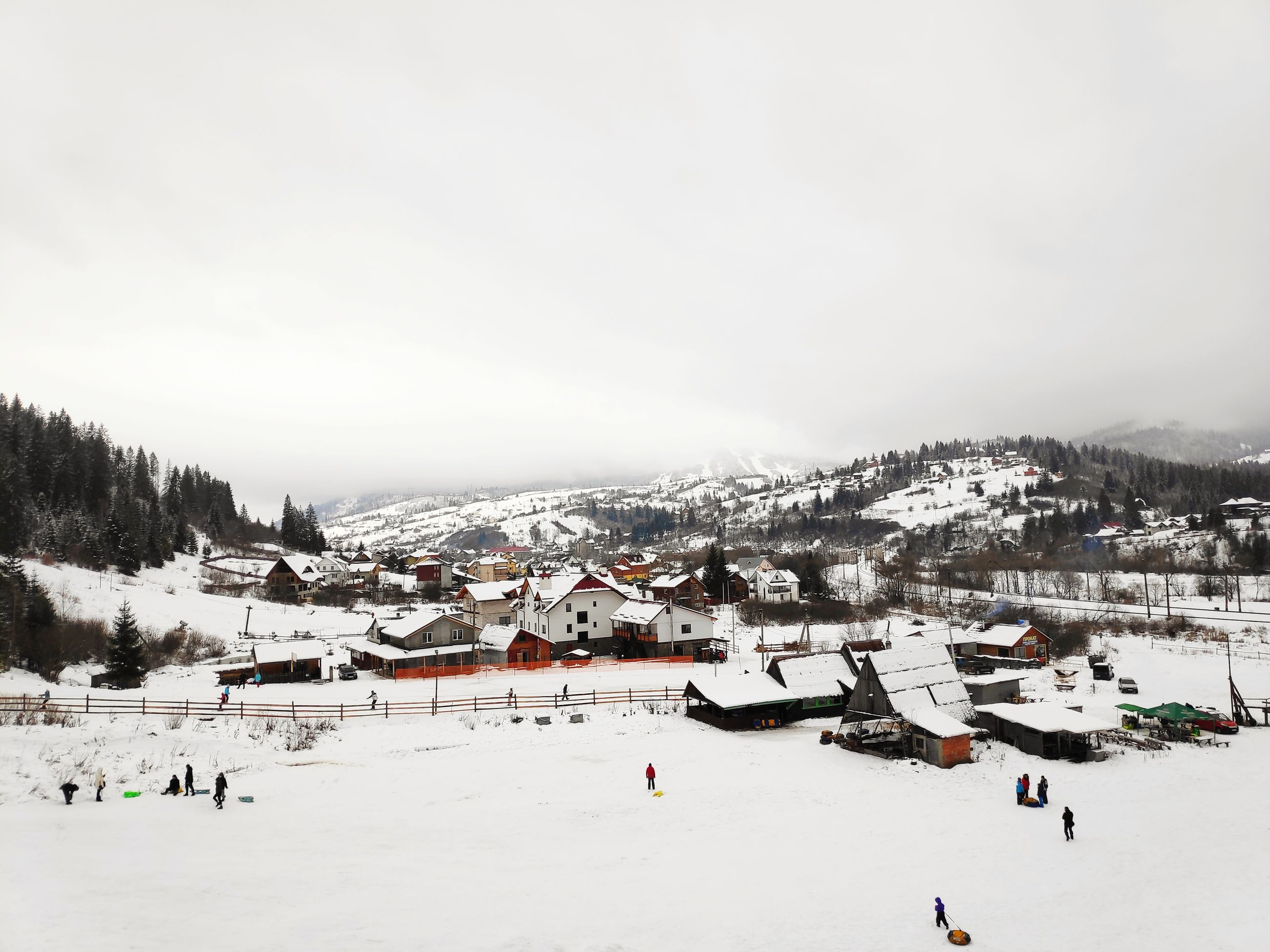 winter, snow, cold temperature, architecture, built structure, building exterior, mountain, sky, building, environment, nature, high angle view, incidental people, day, scenics - nature, house, land, covering, beauty in nature, outdoors, snowcapped mountain