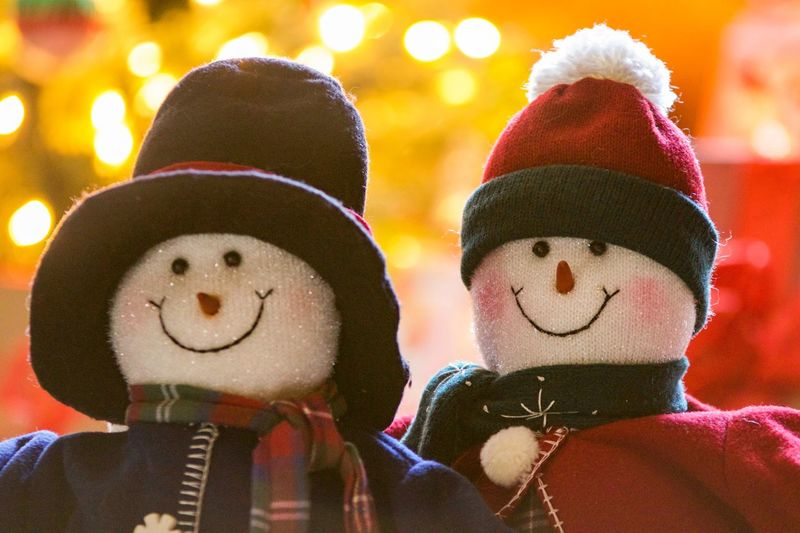 Celebration Snow Holiday Family Fun Christmas Happy Couple Holiday Decorations Couple Snowwoman Snowman Human Representation Focus On Foreground Fun Anthropomorphic Face Snowman Celebration Anthropomorphic Smiley Face Knit Hat Warm Clothing Close-up Outdoors Happiness Enjoyment People