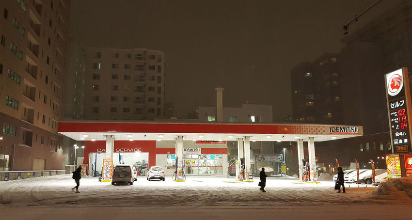Cars Fuel HUAWEI Photo Award: After Dark Snowing Night Building Exterior City City Life Cityscape Gas Station Group Of People Illuminated Light Night Road Snow Snowing Street Street Photography Transportation Walking