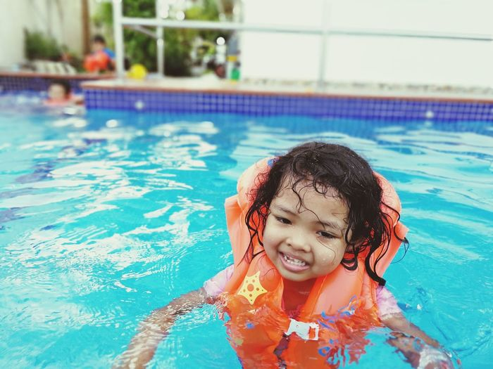 EyeEm Selects Swimming Pool Water Smiling Wet Child Children Only Swimming Happiness Swimwear One Person Cheerful Childhood People Enjoyment Fun Summer Day Healthy Lifestyle Water Slide Portrait Second Acts