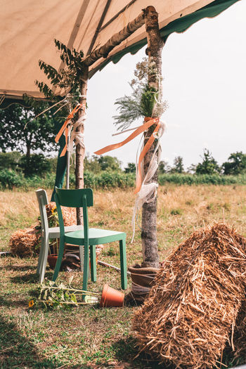 Beautiful outdoor wedding altar set-up with chairs for bride and groom with hay bales and sunflowers