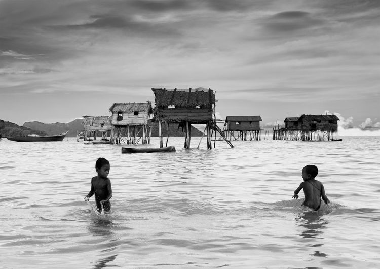 Connected By Travel Boys Built Structure Childhood Nature Outdoors People Sea Shirtless Travel Destinations Two People Water Seagypsy Isolated Island Maiga Island Black And White Friday