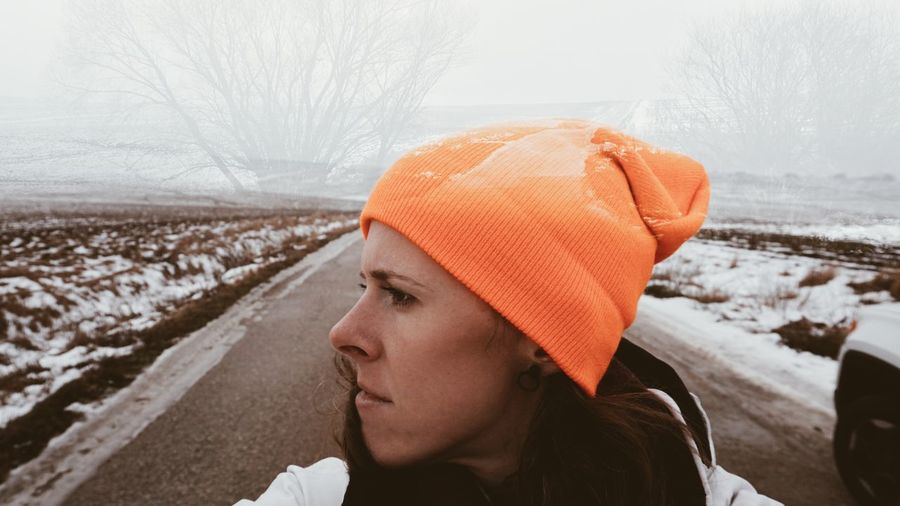 Portrait of mid adult woman looking away during winter