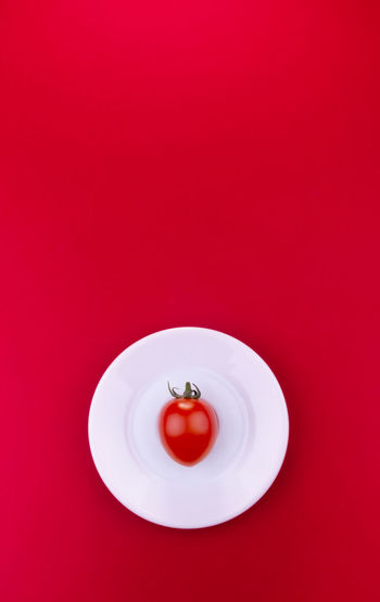Directly above shot of red fruit in plate