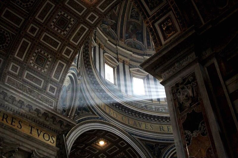 Petersdom Indoors  Architecture Built Structure History Old Vatikan Rome Papst Low Angle View Ceiling Window Arch Ornate Design Architectural Feature The Past Travel Destinations Sunbeam Majestic Tourism UNESCO World Heritage Site Architectural Column Day Famous Place
