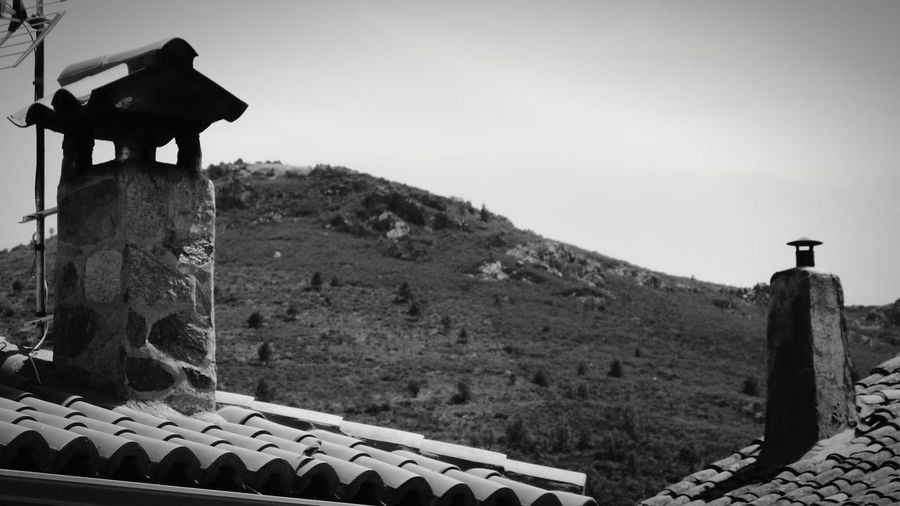 EyeEm Selects Roof History Ancient Old Ruin Travel Destinations Building Exterior Built Structure Ancient Civilization Nature Sky Day Outdoors No People Black And White Stone House Stone Town House Chimneystack Chimneys Montain View Montain
