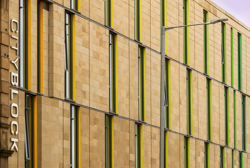 City block Architecture Backgrounds Building Building Exterior Built Structure Day Full Frame In A Row Low Angle View Metal Modern No People Office Office Building Exterior Outdoors Pattern Railing Safety Side By Side Wall - Building Feature Yellow