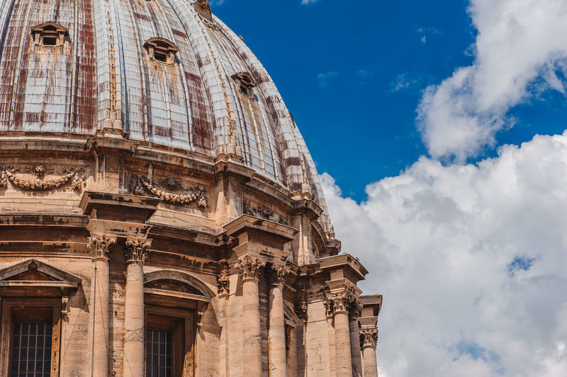 Low angle view of st peters basilica against sky
