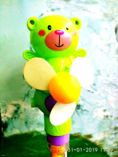 little fan with bear toy Multi Colored Clown Childhood Water Easter Celebration Balloon Anthropomorphic Face Toy Close-up
