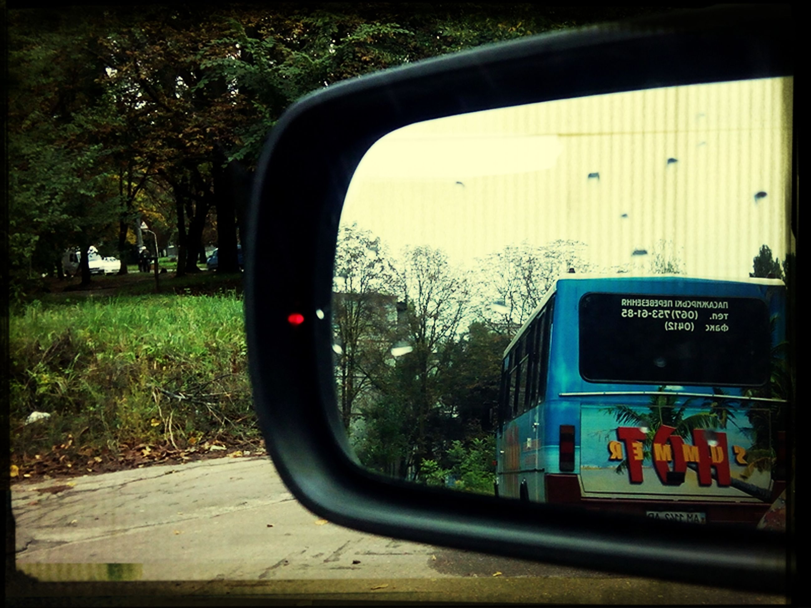 transfer print, transportation, land vehicle, mode of transport, car, auto post production filter, communication, tree, glass - material, side-view mirror, text, road, window, day, transparent, close-up, western script, street, mirror, no people