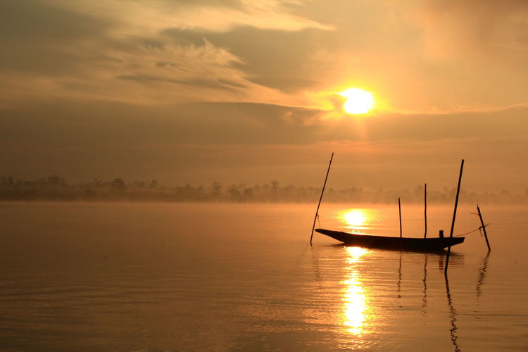 Sunrise fishing boats of Thailand. Sunset Water Nautical Vessel Sky Transportation Waterfront Cloud - Sky Scenics - Nature Sun Beauty In Nature Mode Of Transportation Sea Tranquil Scene Silhouette Orange Color Tranquility Idyllic Nature Reflection No People Outdoors Sailboat