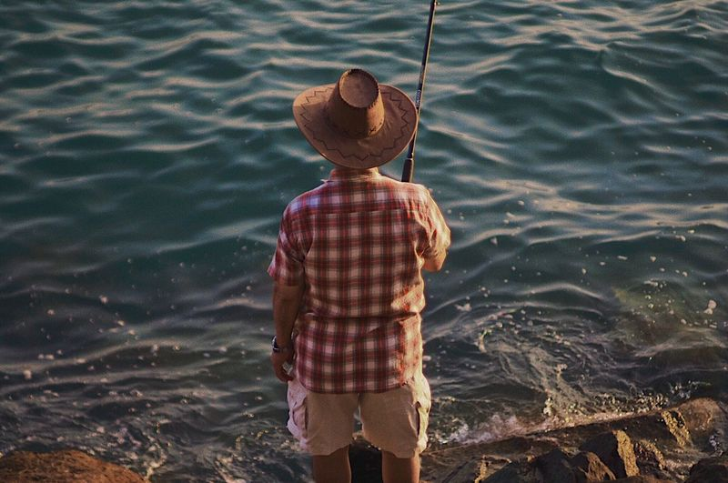 Fishermen Fisherman Fishing Hk Hkig Real People Water One Person Lifestyles Hat Standing Outdoors