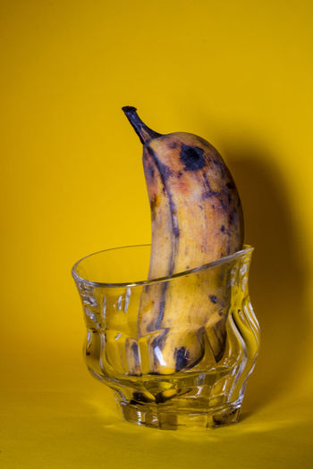 Close-up of drink in bowl against yellow background