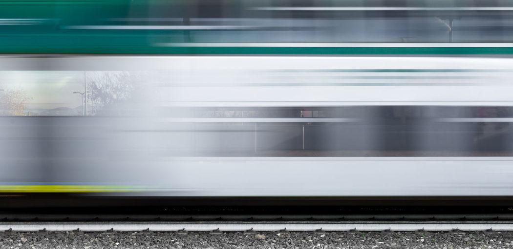 Blurred Motion Of Train At Railroad Tracks