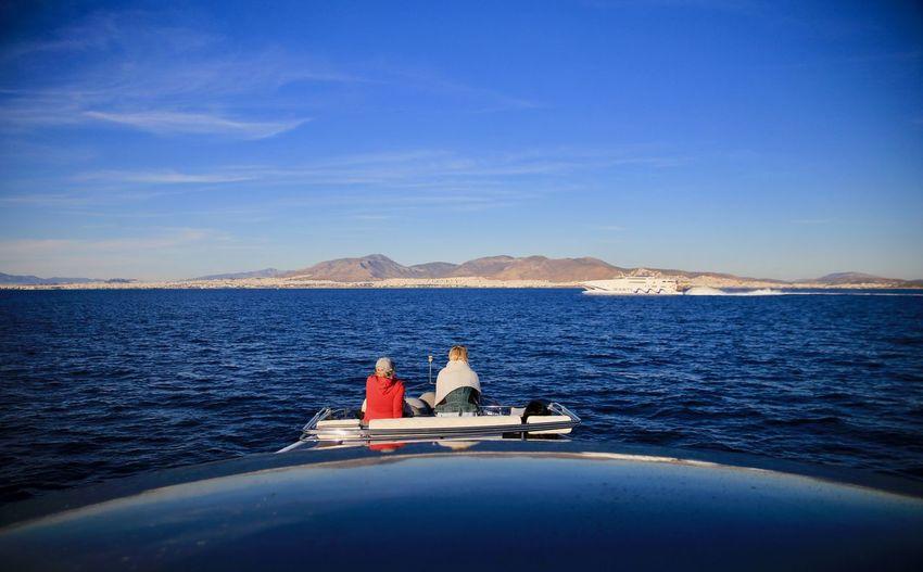 Couple enjoying the view sitting on yacht