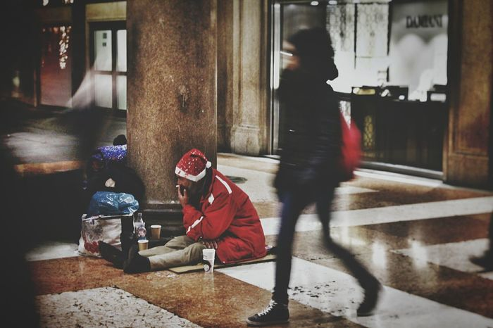 Invisible to their eyes. Outdoors Real People Milan Christmastime 2016 Poorman Vagabond People Evening Poorpeople Help Crisis
