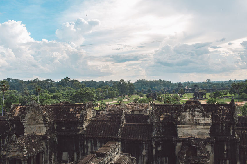 Siem Reap Cambodia Angkor Angkor Wat Angkor Wat, Cambodia Architecture Built Structure History Sky The Past Tree Ancient Cloud - Sky Place Of Worship Old Ruin Nature Plant Ancient Civilization Travel No People Day Travel Destinations Religion Old Belief Outdoors Archaeology Ruined