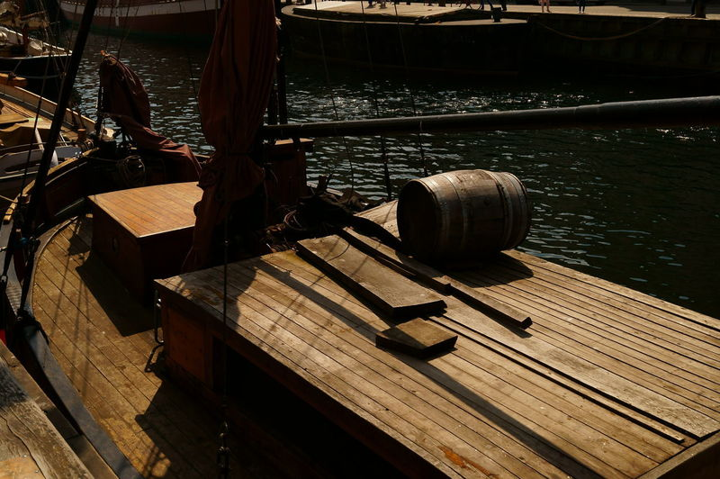 Wood - Material Water Nature Day Sunlight No People Barrel Lake Architecture Pier Outdoors Cylinder Nautical Vessel Container High Angle View Built Structure Transportation