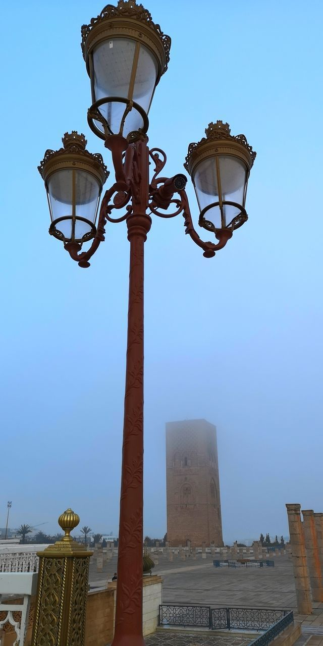 LOW ANGLE VIEW OF STREET LIGHT AGAINST BUILDINGS