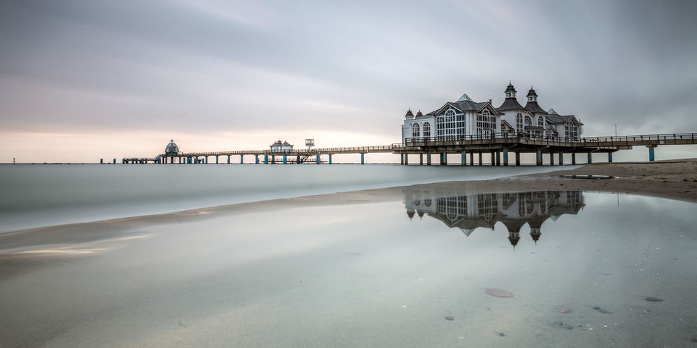 Reflection of building on beach