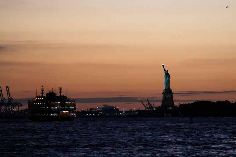 Boat East River, NYC Harbor New York New York City No People Orange Color Rocio Valenzuela S Sea Sky Statue Of Liberty Sunset Tranquility Travel Destinations Water Waterfront