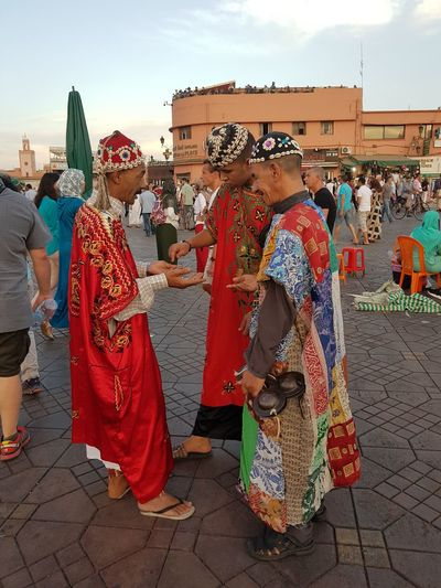 People in traditional clothing against sky