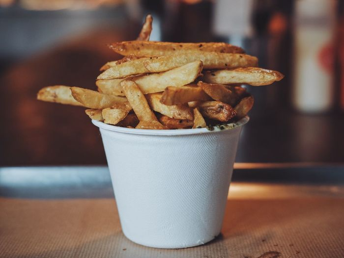 Close-Up Of French Fries In White Disposable Cup