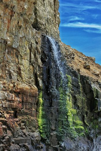 Outdoors Day Nature No People Water Beauty In Nature Sky Close-up Waterfall Falling California, USA California Nature Photography Rock Formation Blue Sky Cliff Algae Erosion Geology Beauty In Nature Textured  Exploring Hiking Drainage Ocean