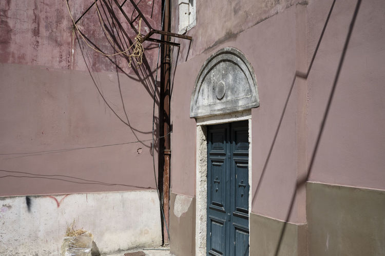 Corfu, Greece - 2018 Pink Color Architecture Textured  Wall - Building Feature No People Building Exterior Built Structure Day Close-up Wall Power Supply Electric Lamp Electrical Equipment Building Door My Best Photo Humanity Meets Technology 17.62°